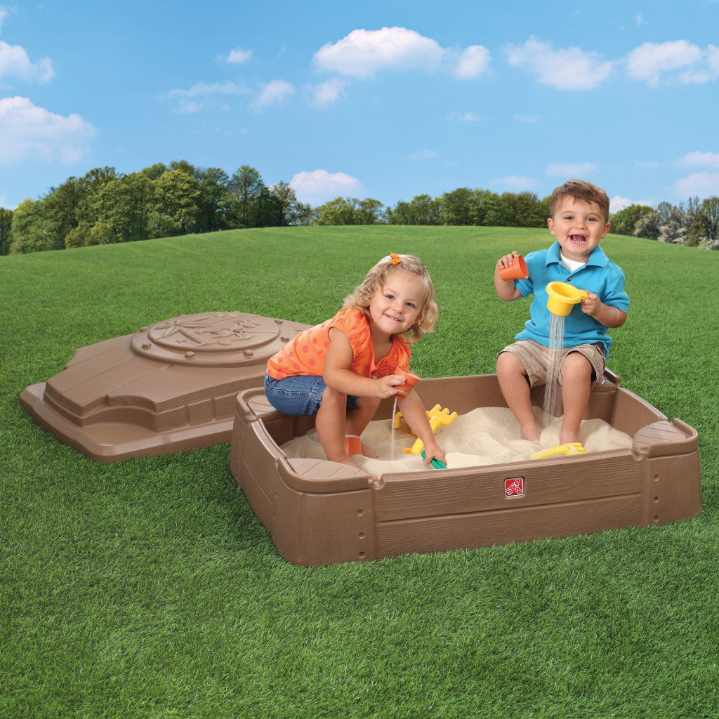 kids playing in a sandbox
