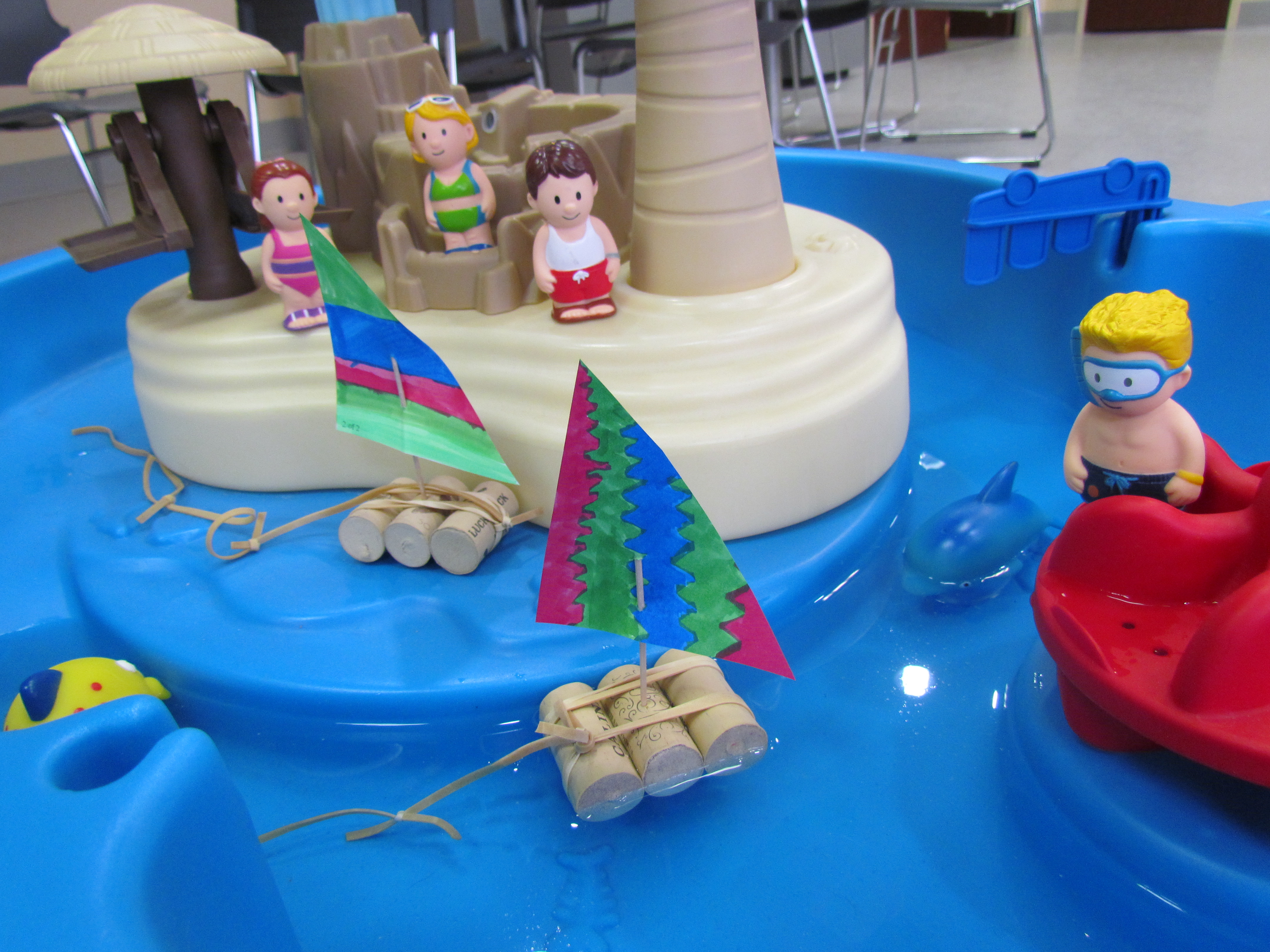 toy boats in kid's water table