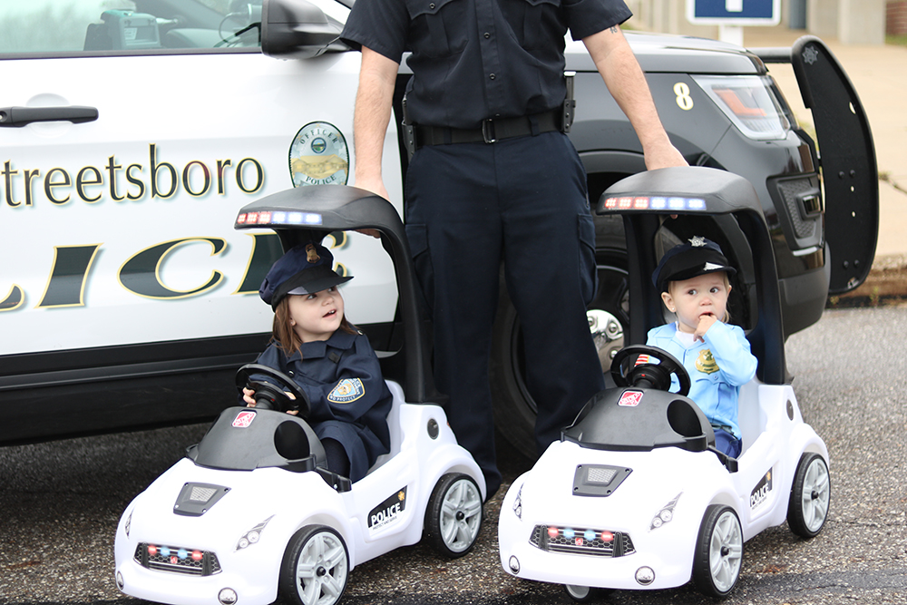 Streetsboro Police Officer - Dad with daughters in Step2 Turbo Coupe Interceptor