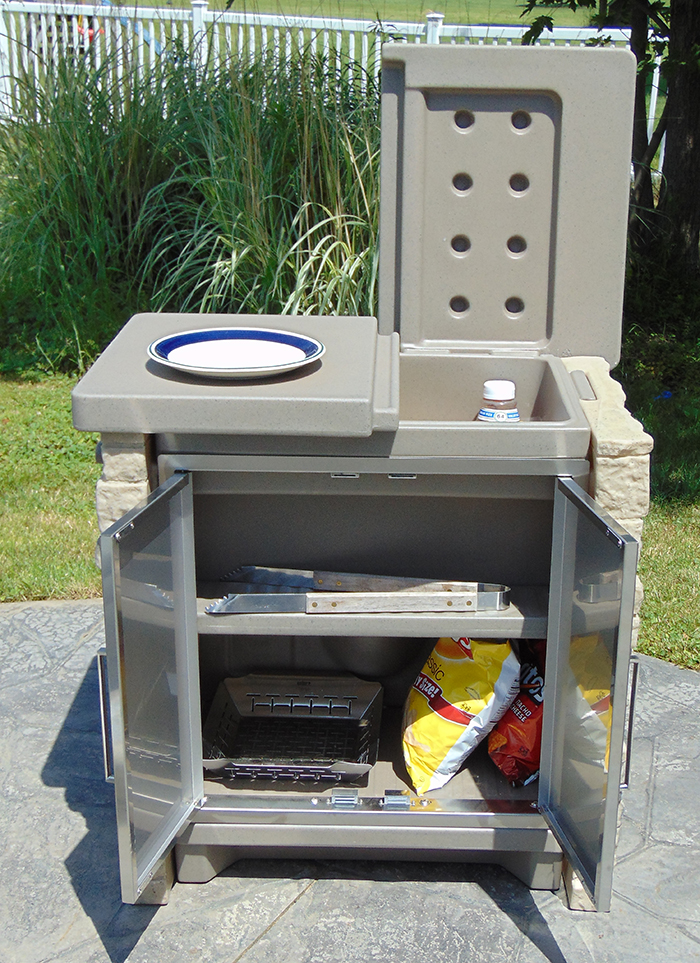 Store cold items as well as grilling accessories in the StoneFront Cooler & Storage.