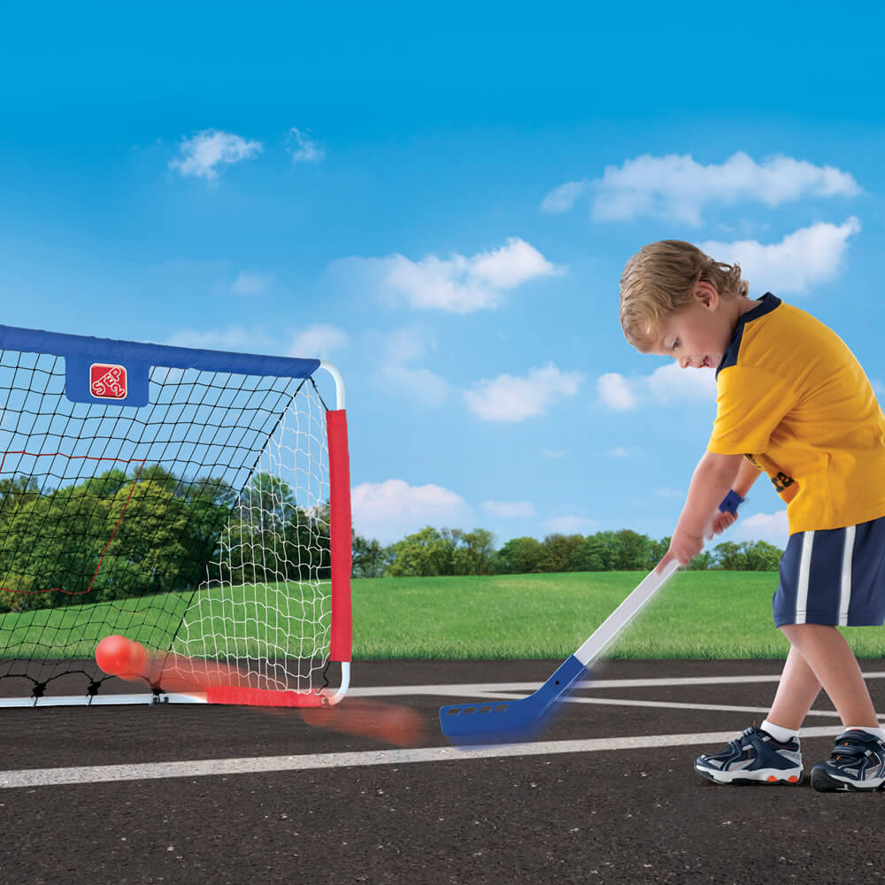 family activity kid playing field hockey